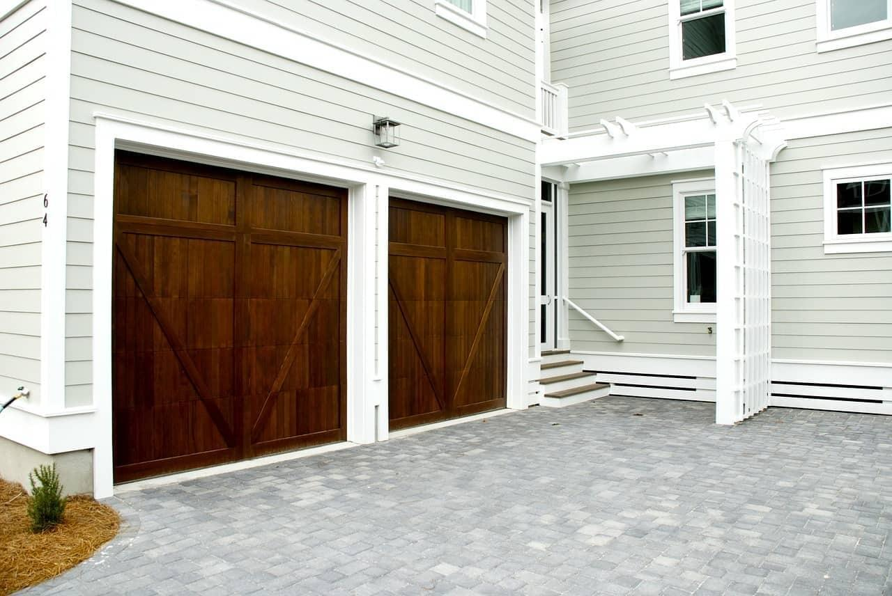 two single car wood garage doors