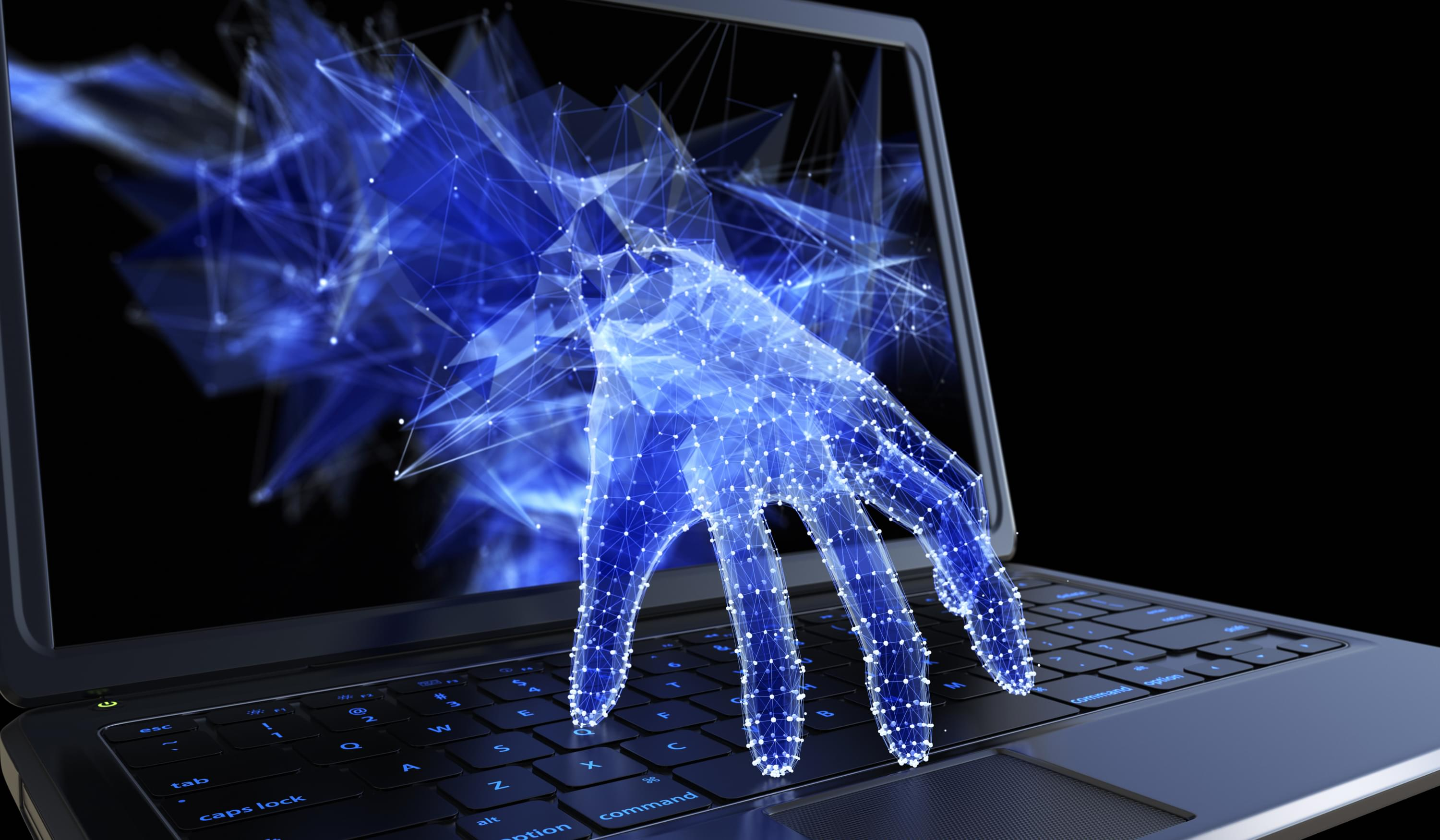 Cyber hand simulation coming out of laptop screen