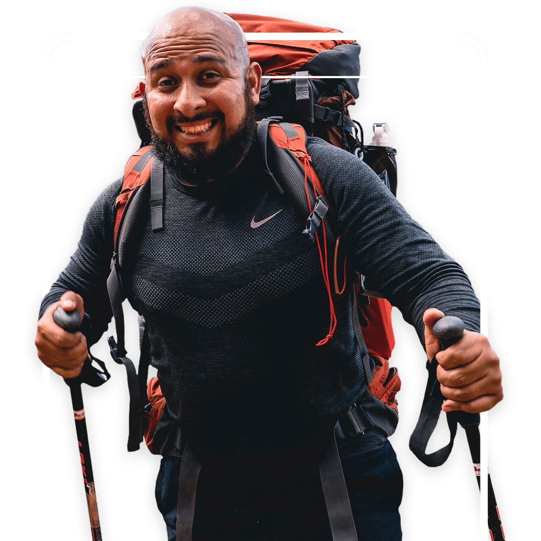 Male adventurer summiting challenging climb