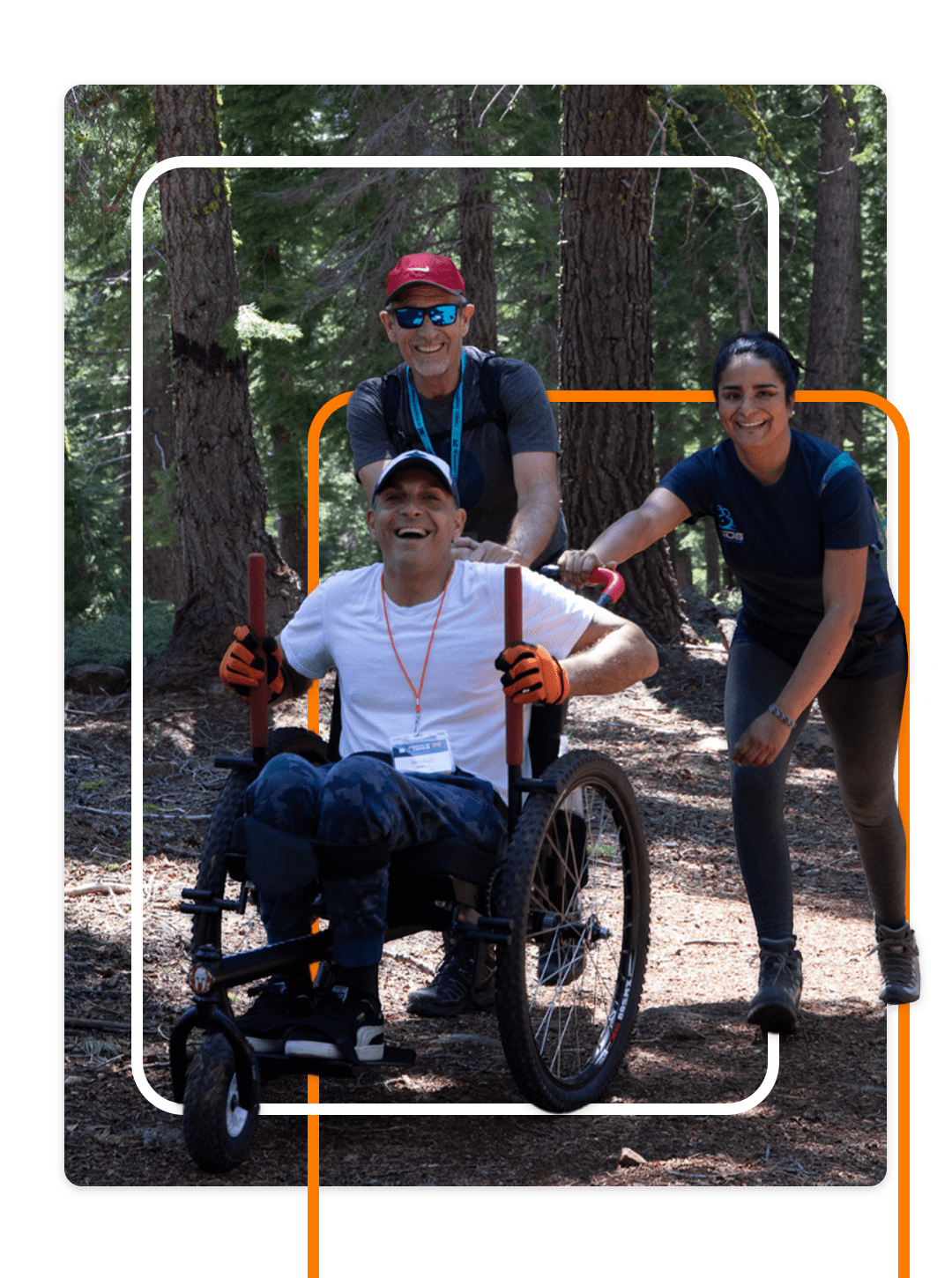 Male adventurer in a wheelchair with his team summiting challenging climb