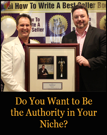 Image of Darren Stephens and Konrad Bobilak holding a plaque at an event