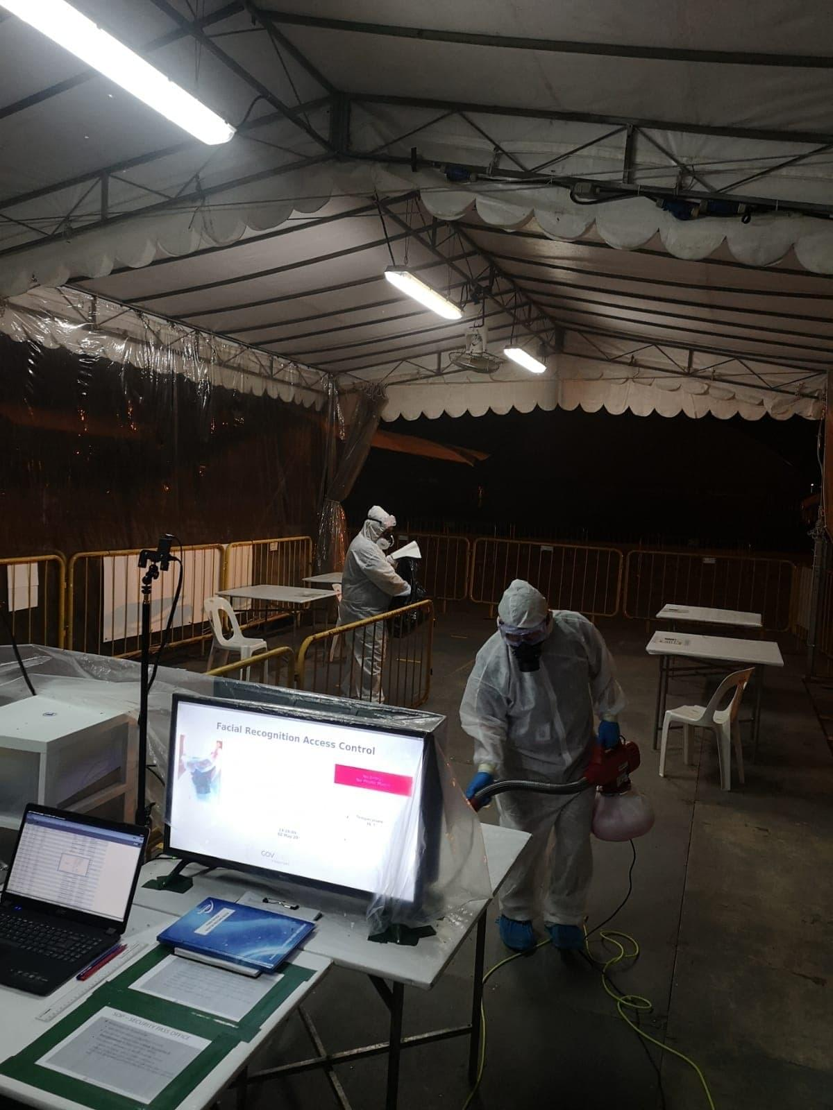 Coronavirus disinfection in progress at a foreign worker dormitory in Singapore