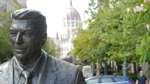 close-up view of statue of ronald reagan on tree-lined street