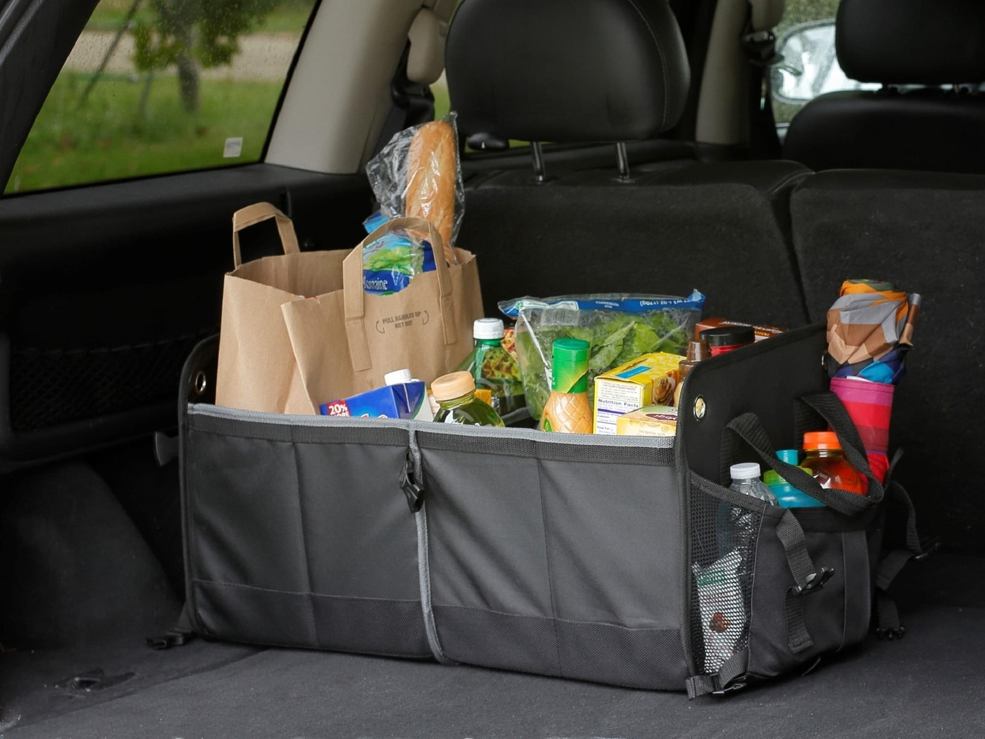trunk organizer shown with automotive supplies in the back of an SUV