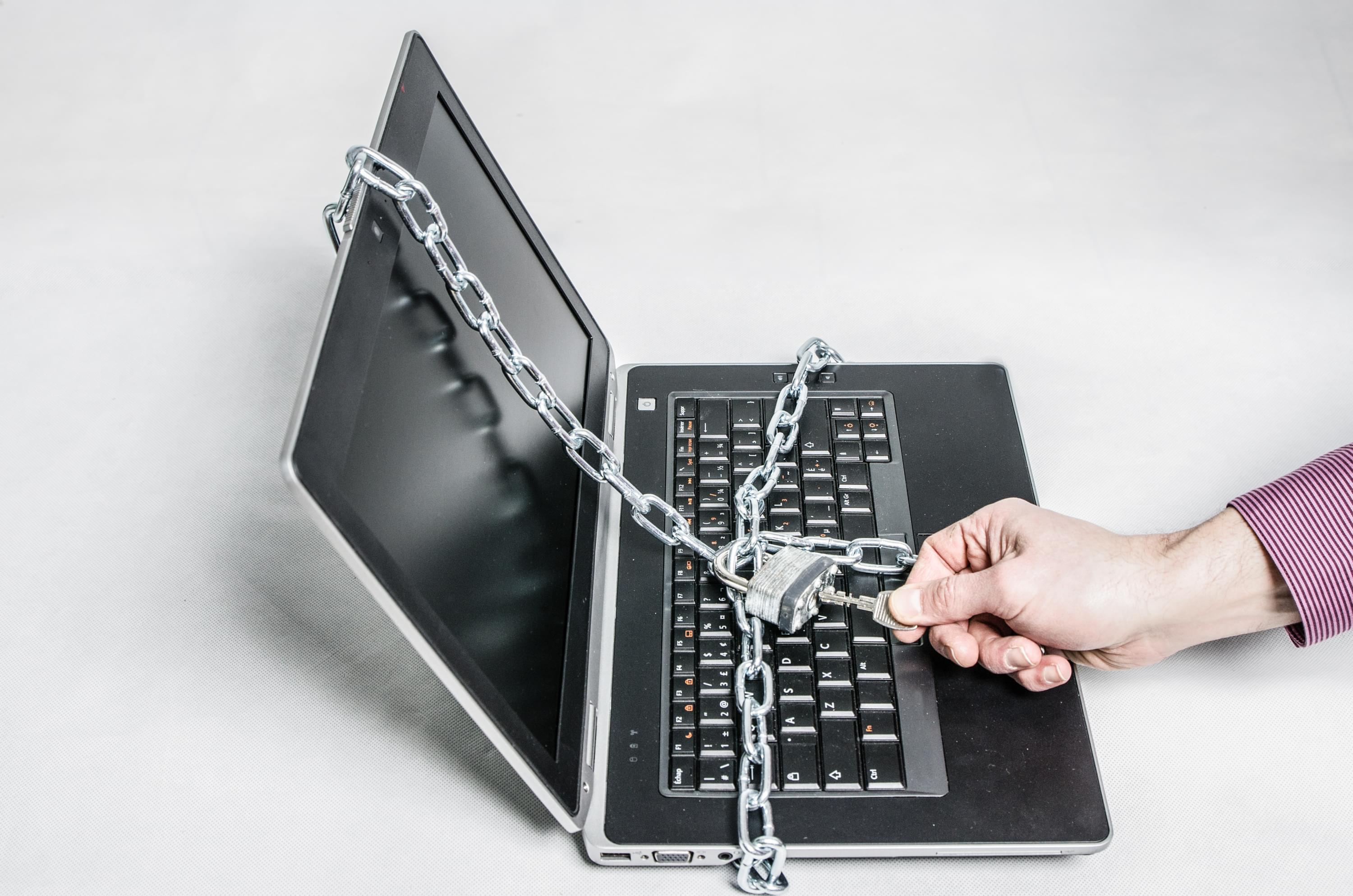 Laptop with chain and lock around it