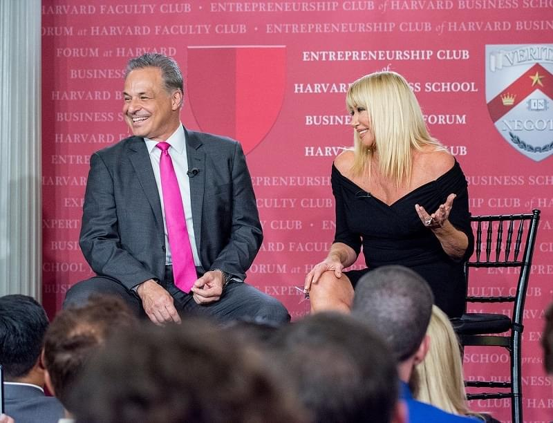 Financial advisor marketre Clint Arthur sharing the stage with actress Suzanne Somers at Harvard Faculty Club