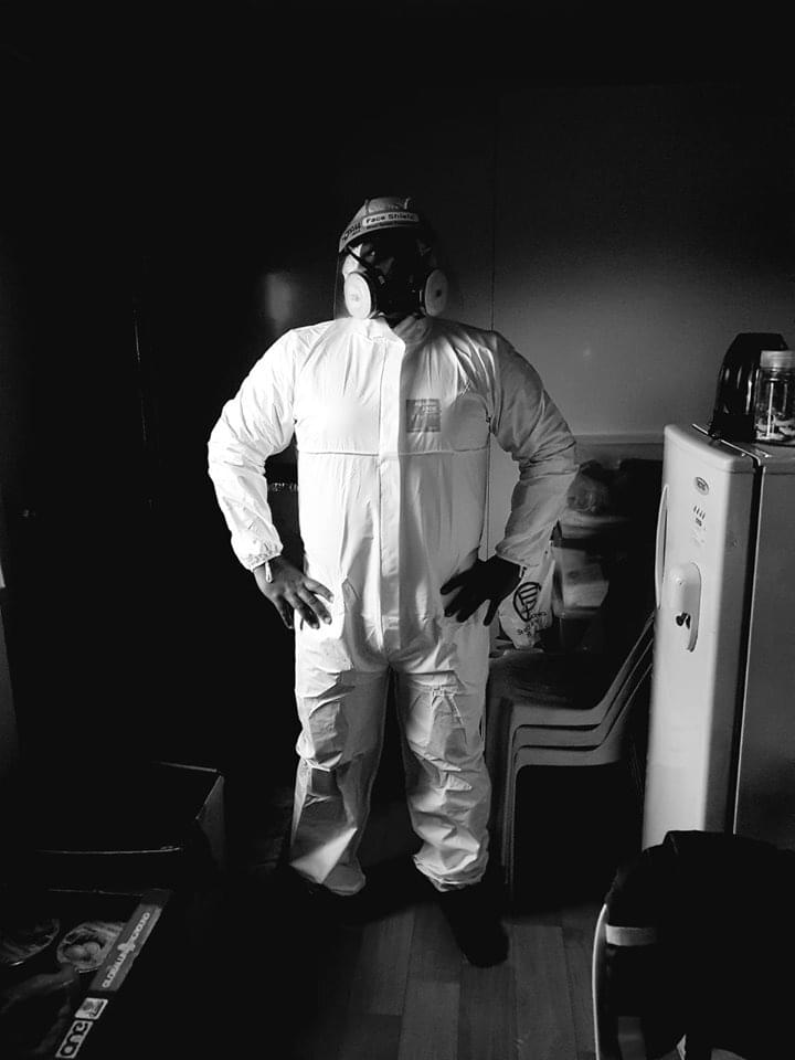 Innovative Pest disinfection specialist in full PPE gear