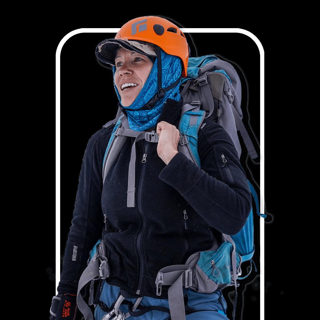 Female adventurer summiting challenging climb