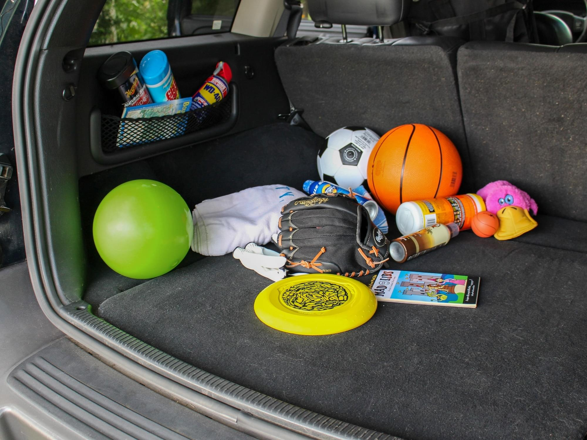 messy SUV with toys in the back cargo area